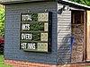 Abridge Cricket Club ground scoreboard in Abridge, Essex, England.jpg