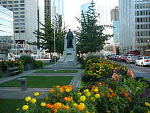 The Adam Beck Memorial Is Located In Landscaped Median Between Northbound And Southbound Lanes Just South Of Queen Street West