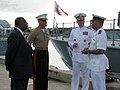 Adm. Walsh discusses Tongan patrol boats with a Tongan naval officer. (5885840203).jpg