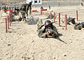 Afghan National Army Basic Warrior Trainee Navigates through obstacle course (5085968060).jpg