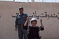 Afghan police build swing set for boys school 120517-M-DM345-021.jpg