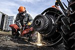 Airman cuts engine with saw 130501-F-YW474-310.jpg