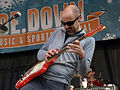Al Schnier from moe. playing guitar at snoe.down 2010 by John Gullo.jpg