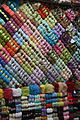 Aleppo, souq, wall of yarn (6362469401).jpg