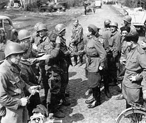 Soviet Union–United States relations - Soviet and American troops meet in April 1945, east of the Elbe River.