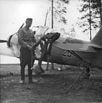 An-air-force-pilot-standing-in-front-of-an-airplane-391765877286.jpg