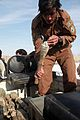 An Afghan Local Police officer examines a rocket-propelled grenade, gathered during a presence patrol by Afghan commandos and coalition special operations forces in Pul-e Khumri district, Baghlan province 120208-A-BT925-004.jpg