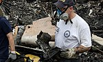 An NTSB investigator carries out one of the recorders from UPS 1354. (9518907464).jpg