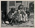 An old Afghan man sits with a woman and child on the ground Wellcome V0019237.jpg