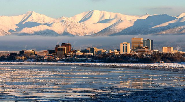 Anchorage By Frank K. from Anchorage, Alaska, USA (View of Anchorage from Earthquake Park) [CC BY 2.0  (https://creativecommons.org/licenses/by/2.0)], via Wikimedia Commons