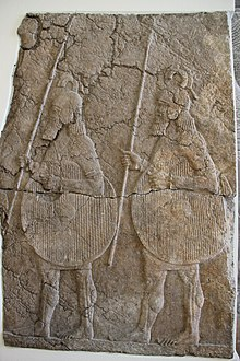 Relief depicting two Assyrian soldiers