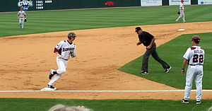 Baseball field - Andy Wilkins rounds third base following a home run for the 2010 Arkansas Razorbacks baseball team.