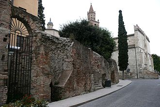Teramo - Remains of the amphitheatre, with the cathedral  in the background.