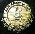 Ann Arbor Organ Co. emblem on antique pump organ.jpg