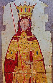 Upper torso of a woman in a full-length scarlet and gold robe, wearing a large golden crown and holding a long thin red scepter.
