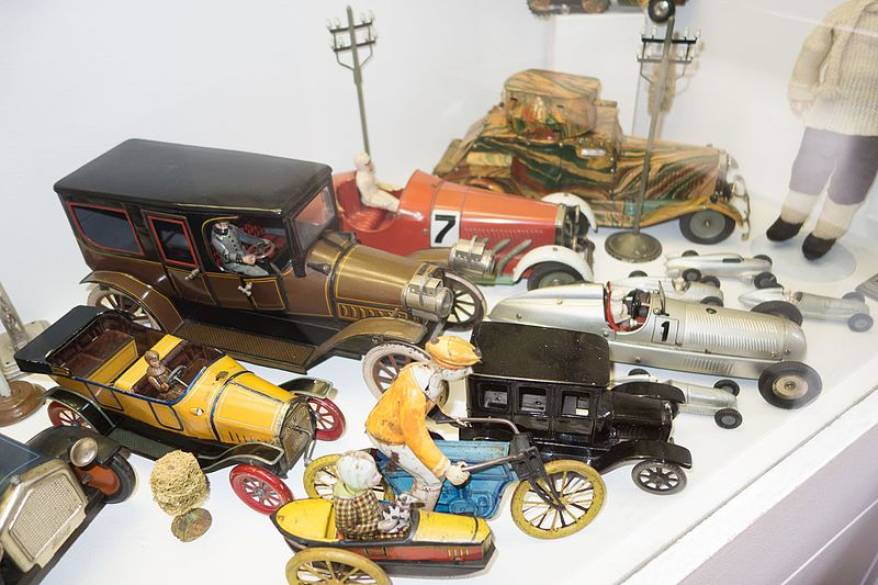File:Antique toy cars and motorcycle (26462824164).jpg