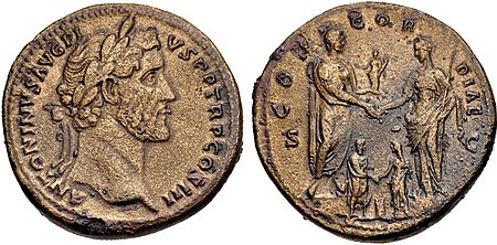 Sestertius of Antoninus Pius (AD 140-144). It celebrates the betrothal of Marcus Aurelus and Faustina the Younger in 139, pictured below Antoninus, who is holding a statuette of Concordia and clasping hands with Faustina the Elder. Inscription: ANTONINVS AVG. PIVS P. P., TR. P., CO[N]S. III / CONCORDIAE S.C. Antoninus Pius, sestertius, AD 140-144, RIC III 601.jpg