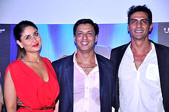 Arjun Rampal - Rampal(right) with co-star Kareena Kapoor and director Madhur Bhandarkar during the launch of the film Heroine', in 2012.