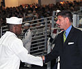Assistant Secretary of the Navy for Manpower and Reserve Affairs Juan M. Garcia III (right) congratulates Seaman Recruit Aaron Anderson from Mukilteo, Wash., for receiving the Military Order of the World Wars 120727-N-IK959-888.jpg