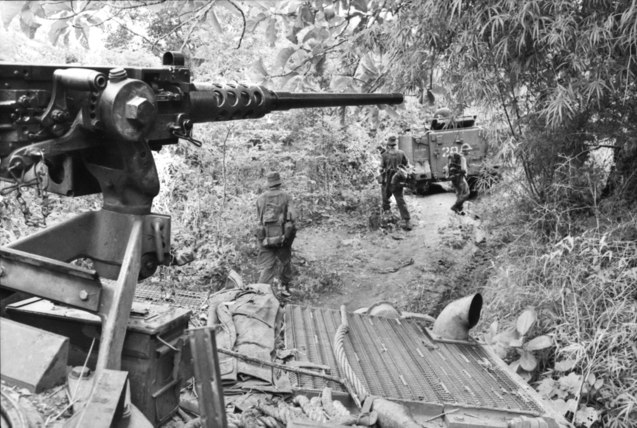 Australian APCs and soldiers during Operation Smithfield in 1966