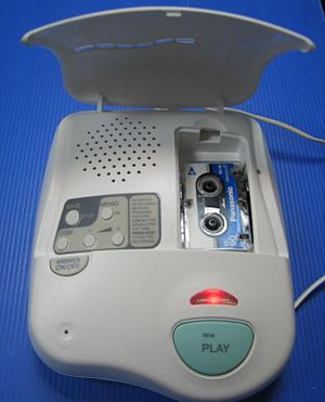Answering machine - An answering machine that uses a microcassette to record messages