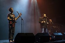The Axis of Awesome (left to right: Lee Naimo, Jordan Raskopoulos, Benny Davis) performing c. 2011