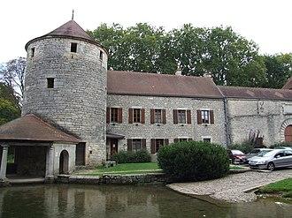 Bèze Abbey - Abbaye Saint-Pierre, Bèze river, northwest side. 15th century Oysel tower and 18th century wing