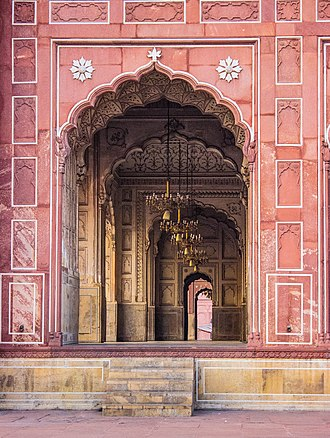 Badshahi Mosque - Entrance to the main prayer hall is through arches made of red sandstone and elaborately carved white marble.