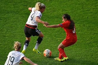 Bahar Güvenç - Bahar Güvenç (red) trying to stop a German attack at the UEFA Women's Euro 2017 qualifying Group 5 match in Istanbul, Turkey.