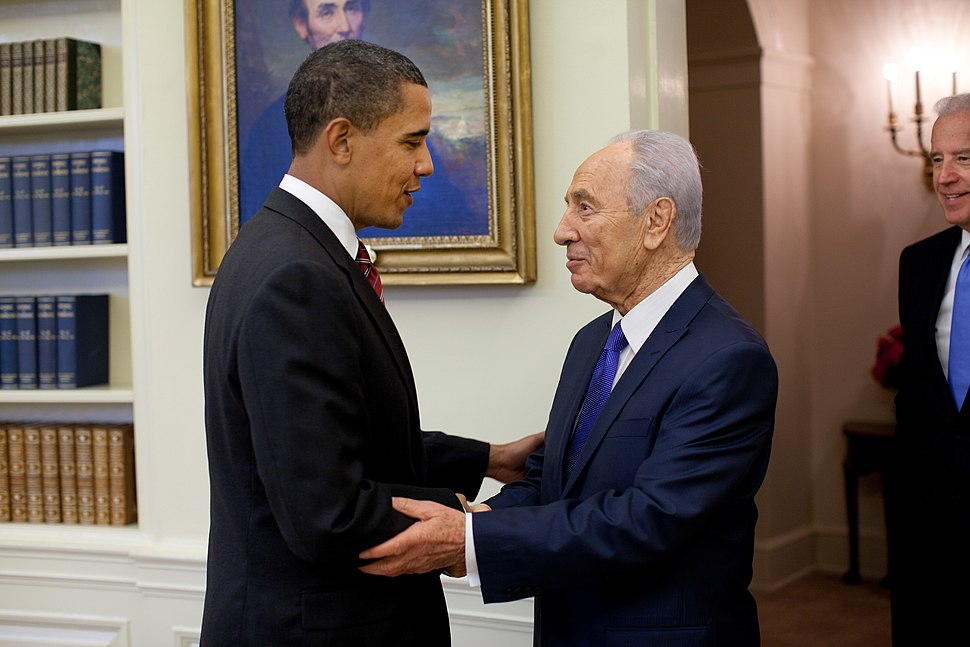 President Barack Obama, at left, shakes hands with Israeli President Shimon Peres, at right, in the Oval Office on Tuesday, May 5, 2009. Standing at right looking on is U.S. Vice President Joe Biden.