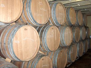 Traditional wooden lambic barrels; the L on th...