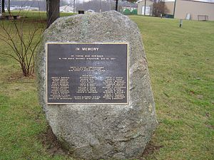 bronze plaque listing the people's names who died during the disaster (with the exception of the Kehoes), fixed to a large boulder