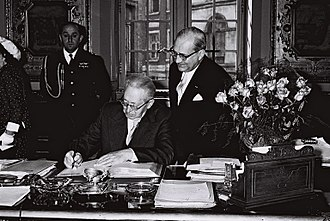 Lucien Cooremans - Lucien Cooremans standing by the President of Israel, Yitzhak Ben-Zvi as he signs the visitors book at Brussels city hall