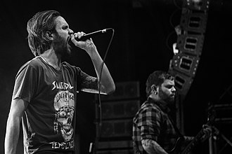 Tommy Giles Rogers Jr. - Rogers (left) with Between the Buried and Me in Cologne, 2015