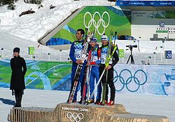 Biathlon men's 15 km mass start medalists at 2010 Winter Olympics.jpg