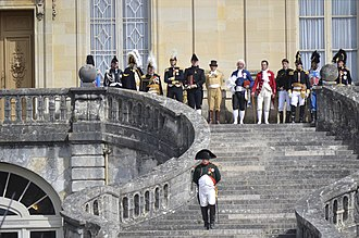 Fontainebleau - Historical reenactment in Fontainebleau of the bicentenary of Napoleon's Farewell to the Old Guard, April 20th of 2014. Napoleon is going down the famous stairs of Fontainebleau castle to meet with the Old Guard.