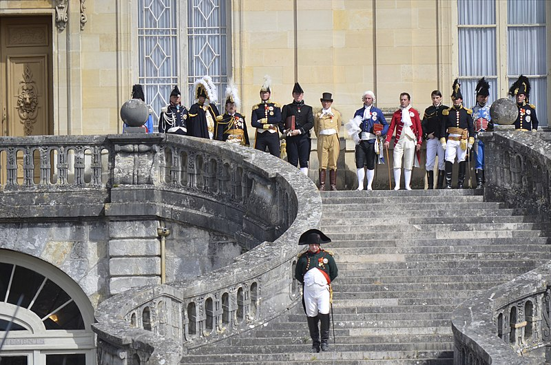 Historical reenactment in Fontainebleau of the bicentenary of Napoleon's Farewell to the Old Guard, 20 April 2014. Napoleon is going down the famous stairs of Fontainebleau castle to meet with the Old Guard. Bicentenaire des Adieux de Napoleon a Fontainebleau.JPG