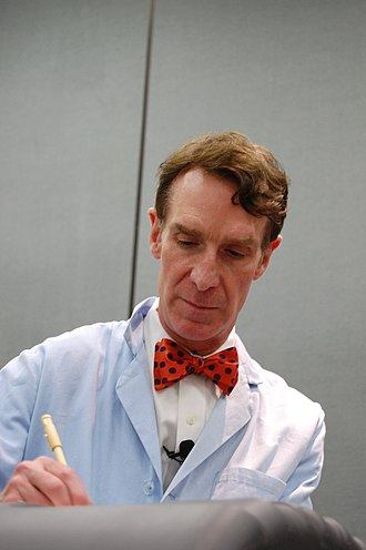 Bill Nye - Bill Nye the Science Guy, wearing his trademark blue lab coat and bowtie.