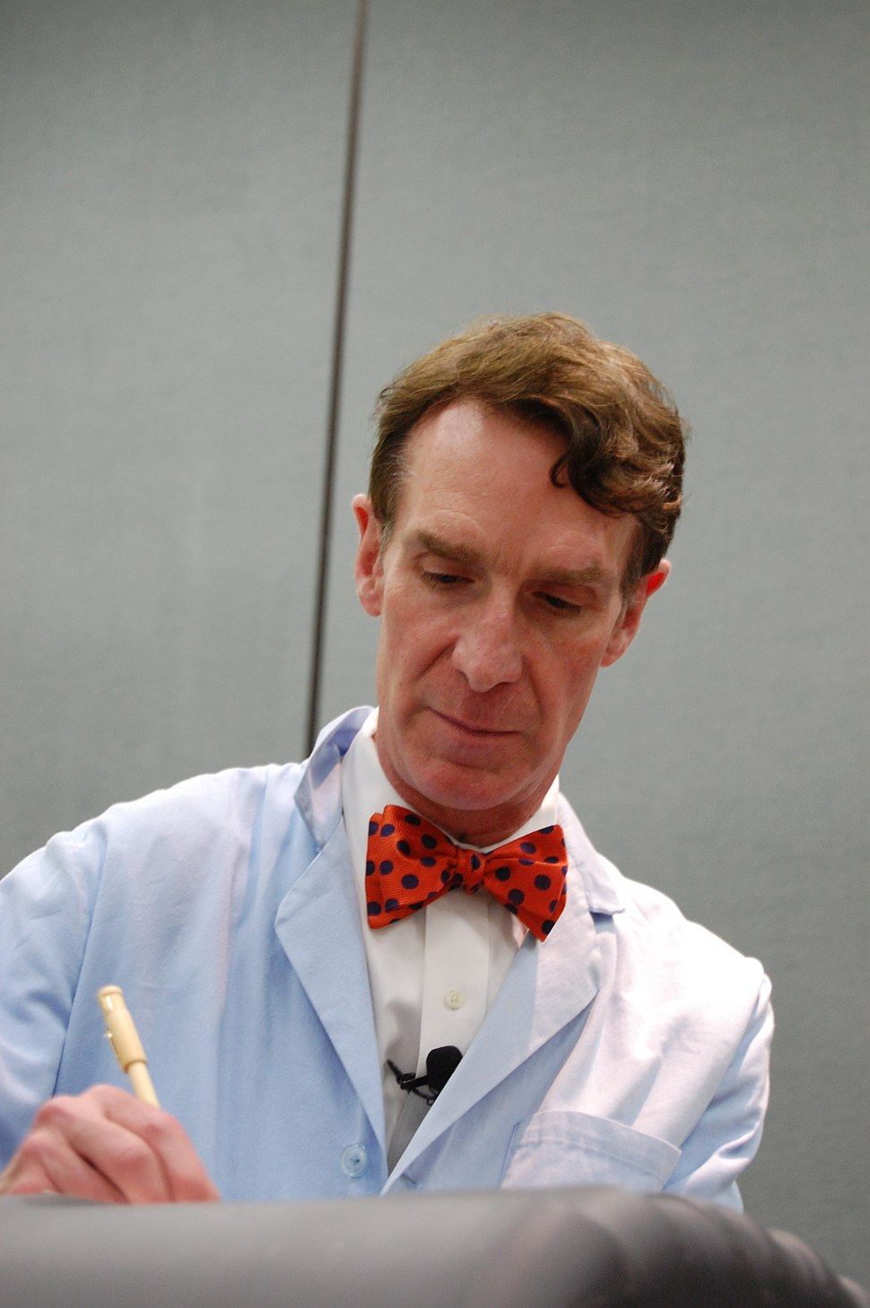 Bill Nye with trademark blue lab coat and bowtie