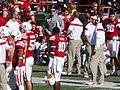 Bo Pelini with players during a timeout (Nebraska vs. Rutgers, 2014).jpg