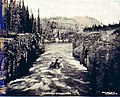 Boat navigating the Miles Canyon Rapids on the Yukon River, Yukon Territory, 1899 (MEED 200).jpg