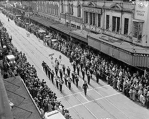 John Duthie (politician) - Brass band marching in Willis Street, Wellington, 1951, with the John Duthie shop in the third building from right