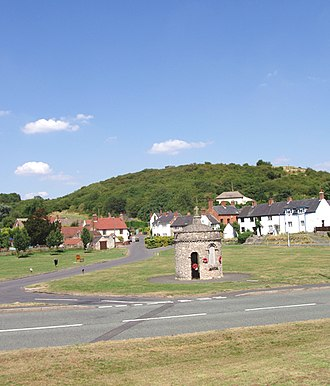 Breedon on the Hill - Breedon's limestone hill rising above the village green and war memorial