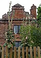 Brick house hollyhocks Goodnestone Dover Kent England.jpg
