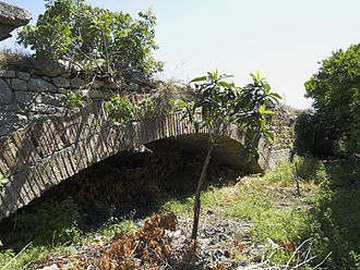 Bridge near Limyra - The 4th arch, today half-buried. The exceptionally flat profile of the arch is evident.