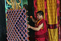 Buddhist monk making 'ghost catcher', Sikkim, India (8083502879).jpg