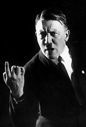 Religious views of Adolf Hitler - Adolf Hitler in 1927, rehearsing his oratorical gestures; photo by Heinrich Hoffmann