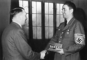 Fritz Todt - Speer (right) awarded an Org.Todt ring by Hitler – May 1943