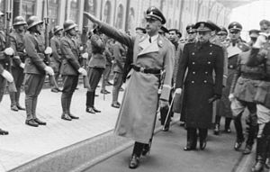 Ramón Serrano Suñer - Heinrich Himmler at Madrid Northern Railway Station, October 1940, being honored by Spanish soldiers. Ramón Serrano Suñer is in a dark uniform worn by the Spanish Fascist Party leaders at that time