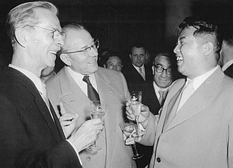 Kim Il-sung - Kim on a 1956 visit to East Germany, chatting with painter Otto Nagel and Prime Minister Otto Grotewohl.